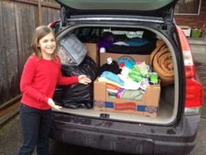 Here's Hattie getting ready to deliver all then items she collected for runaway youth during last year's drive.